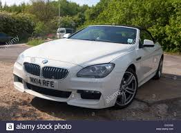 White BMW 6 Series M Sport Convertible 2 door 640d parked Stock
