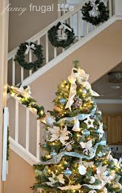 Christmas 2012 Home Decor Tour | Christmas Decorating Ideas For Porch Railings Rainforest Islands Christmas Garlands With Lights For Stairs Happy Holidays Banister Garland Staircase Idea Via The Diy Village Decorations Beautiful Using Red And Decor You Adore Mantels Vignettesa Quick Way To Add 25 Unique Garland Stairs On Pinterest Holiday Baby Nursery Inspiring The Stockings Were Hung Part Staircase 10 Best Ideas Design My Cozy Home Tour Kelly Elko