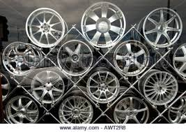 Designer Alloy Aluminium Car Wheels Stacked On A Metal Rack In Shop Window Display