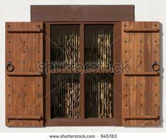 Spanish Style Window With Shutters Coconut Shell Curtains Stock Photo 945783 Shutterstock Rustic ShuttersHouse