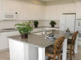 KitchenBeautiful Neutral White Kitchen Decor Using Grey Marble Island Countertop Plus Rattan Potted Plants