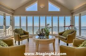 Value City Furniture Nj for a Beach Style Sunroom with a Monmouth County Nj Home Stagers and Luxury Home Staging in Ocean City Nj Cape May County