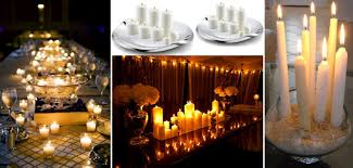 Stunning Array Of White Pillar Candles In Metallic Cutout Vases At Wedding Reception