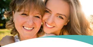 Older Woman And Younger Smiling