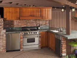 KitchenOpulent Stainless Steel Cabinets For Outdoor Kitchens With Brick Backsplash And Ceiling Panels Opulent
