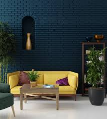 colorful living room with blue brick wall and yellow sofa