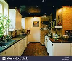100 Brick Walls In Homes REAL HOMESKitchen Dark Wood Ceiling Terracotta Tiles In Pattern On