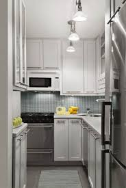 awesome white kitchen with backsplash tile and track lighting