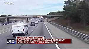 100 Truck Hits Overpass Exclusive Video Shows Semi Hitting Overpass Forcing I96 Freeway