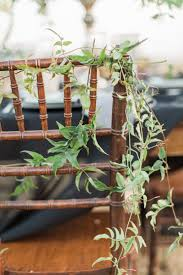 Vines Wrapped Around Back Of Wood Chair Rustic Boho California Reception Wedding Decor