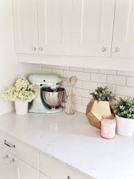 Creamy White Shaker Style Kitchen Cabinets Subway Tile Back Splash Crystal Knobs Nickel Pulls Quartz Counters Mint Mixer