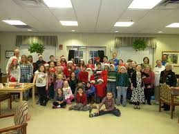 Holiday carolers visit nursing home Bulletin