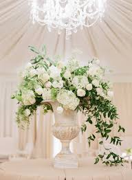 Inspiration for Ceremony tall arrangements Maybe add a little tiny