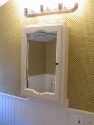 bathroom lighting bathrooms above bathroom light fixtures