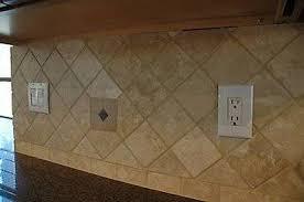 how to install a travertine tile backsplash hunker