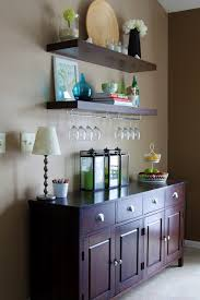 What a perfect way to set up a bar Floating shelves above a