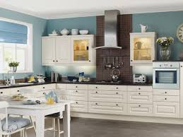 creative kitchen paint with light wood cabinets below counter top