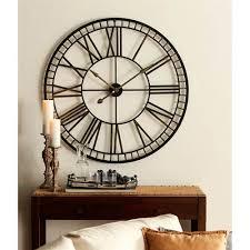 gold and black wall clock