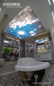traumhafter wolkenhimmel über der badewanne wandgestaltung