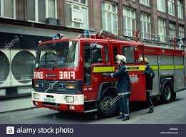 Firefighters Getting Into Fire Engine London England UK T Black ...