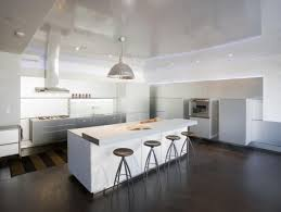 View In Gallery Open Plan Contemporary Kitchen Featuring Dark Wooden Flooring And White