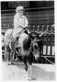Kwolek At Age Three Sitting On A Small Horse In Black And White Photo
