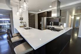 L Shaped Kitchen Island This Sleekly Contemporary Sports Dark Hardwood Flooring And Cabinetry Tones To Match With A