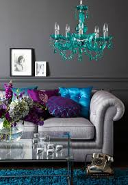 Room 1 In This The Dark Grey Walls And Light Sofa Are Jazzed Up With Varying Patterns Textured Turquoise Fuchsia Violet Cushions