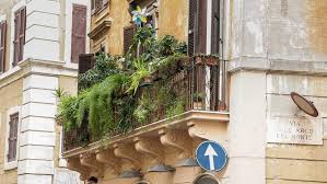 Balcony With Flowers On An Old Yellow Apartment Building In Rome Photo By Photoweges