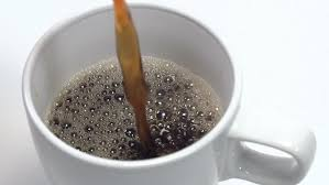 Slow Motion Close Up Of Coffee Pouring Into A Cup