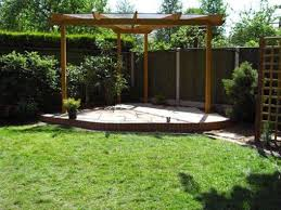 Landscaping And Outdoor Building , Unique Triangular Pergola ... Outdoor And Patio Corner Backyard Koi Pond Ideas Mixed With Small Garden Designs On A Budget Back Pictures The Backyard Corner Farmhouse Flower Landscaping Simple Best Landscape For Privacy Emerson Design Wood Fireplaces Burning Quotes Latest Fire Pit Area Some Tips In Beautiful Decor Formal Front Australia Modern Zandalus Pergola Amazing Pergola Plans Wooden Brown Fence Fencing Sod Irrigation System