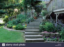 WOOD STAIRWAY THROUGH TERRACED GARDENS LEAD FROM DECK TO BACKYARD ... 25 Trending Sloped Backyard Ideas On Pinterest Sloping Modern Terraced House Renovation Idea With Double Outdoor Spaces Pictures Small Garden Terrace Best Image Libraries Designs Backyard Patio Design Ideas Serenity Creek Landscaping With Attractive Block Retaing Wall Loversiq Before After Youtube Backyards Mesmerizing Beautiful Yard Landscape Download Gurdjieffouspenskycom 41 For Yards And