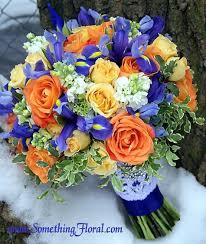 Blue iris wedding bouquet with orange flowers Audrie
