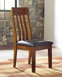 The Ralene Medium Brown Dining Upholstered Side Chair Available At