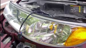 lincoln continental headlight assembly removal replacement 1998