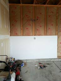 Hanging Drywall On Ceiling Or Walls First by Finishing The Garage Part 1 Insulating And Drywalling Walls And