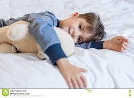 boy in pajamas at bed stock photo image 70944702