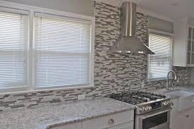 grey glass tile backsplash painted kitchen cabinets reseal