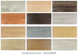 Wood Texture Floor Samples Of Laminate And Vinyl Tile On Wooden Background For New Constuction