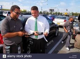 Boston Massachusetts Logan International Airport BOS Alamo Car Rental Black man employee agent using hand