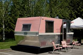 Photo Shows Rear View Of Beautifully Restored Pink And White 1961 Holiday House Vintage Trailer