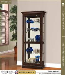 Curved Glass Curio Cabinet by Howard Miller Modern Cherry Curio Cabinet 680580 Berends