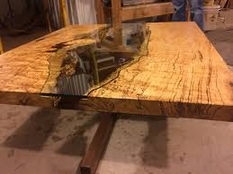 table of spalted maple live edge slab and hand cut glass coffee
