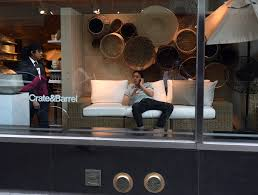 A Shopper Is Caught By Security In Store Window Display As He Has Phone