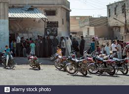 residents queue to buy bread in the town of tel abyad raqqa
