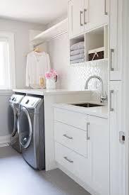 Small Laundry Room Glass Mosaic Backsplash White Cabinets Grey Floor Tiles