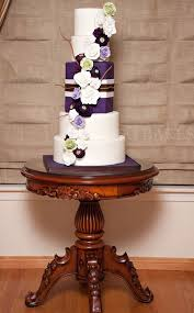5 Tier White Wedding Cake With Purple Flowers And Present Insert