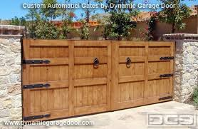 Rustic Wood Driveway Gate With Decorative Iron Hardware Dummy Ring Pulls Hinges Get Quotes From Dynamic Garage Door By DynamicGarageDoors