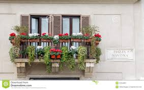Download Balcony With Flowers On An Old Yellow Apartment Building In Rome Stock Image