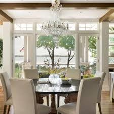 Example Of A Country Medium Tone Wood Floor And Brown Kitchen Dining Room Combo